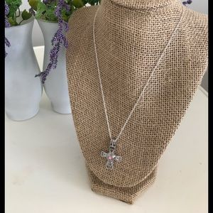 Silver cross necklace and essential oil diffuser